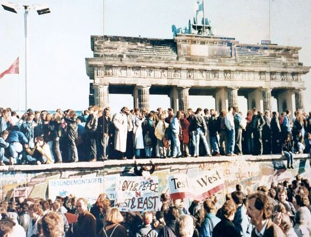 crowds of East and West Germans gather as the Berlin Wall opens